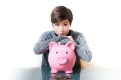 Thinking about savings on a piggy bank Stock Image