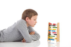 Thinking schoolboy and abacus Royalty Free Stock Image