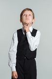 Thinking schoolboy Royalty Free Stock Photography