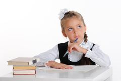 Thinking schoolgirl Royalty Free Stock Image