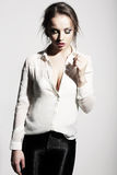 Thinking Seductive Woman in White Blouse Stock Photo