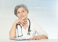 Thinking senior doctor Stock Photo
