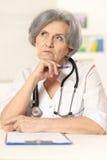 Thinking senior doctor Stock Image