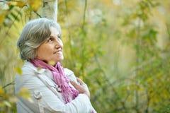 Thinking senior woman Stock Photography
