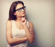 Thinking serious young woman in glasses looking. Vintage closeup Royalty Free Stock Image