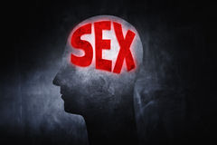 Thinking about Sex. Word Sex glowing on a man's head insted of brains Royalty Free Stock Images