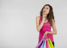 Thinking shopping woman Stock Photo