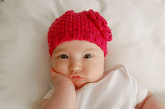 Thinking/skeptical baby Stock Photography