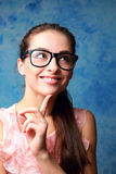 Thinking smiling woman looking up in glasses Stock Photos