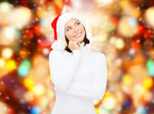Thinking and smiling woman in santa helper hat Royalty Free Stock Photo