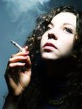 Thinking and smoking Royalty Free Stock Image