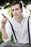 Thinking and smoking Stock Photography