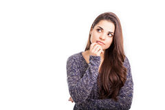 Thinking about something important. Pretty young Hispanic woman looking thoughtful while looking towards copy space Royalty Free Stock Images