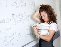 Thinking student at blackboard Royalty Free Stock Photo