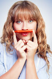 Thinking student with orange crayon moustache Stock Image