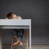 Thinking student sitting at desk Stock Photos