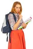 Thinking students woman. Holding notebooks isolated on white background Royalty Free Stock Image