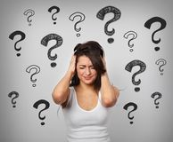Thinking suffering concentrate unhappy with head pain and migraine woman holding the head with big drawing creative questions stock images