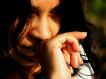 Thinking Teen. A beautiful Indian girl crying lost in some memory Stock Photos