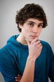 Thinking teen boy Stock Images