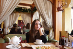 Thinking teen in the restaurant Royalty Free Stock Photo