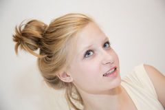 Thinking teenager girl with blonde hair Royalty Free Stock Image