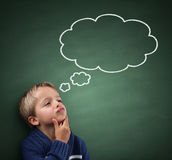 Thinking with thought bubble on blackboard Royalty Free Stock Images