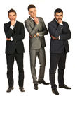 Thinking three business men. Full length of three business men with problems isolated on white background Stock Images