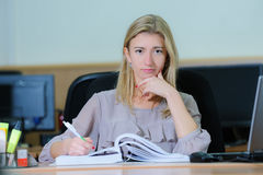 Thinking tired businesswoman holding a pen Stock Photography