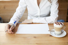 Thinking to write on sheet Stock Images