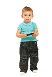 Thinking toddler holding cellphone Stock Photo