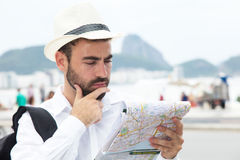 Thinking tourist with map at Rio de Janeiro Royalty Free Stock Photos