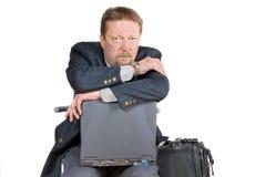 Thinking traveling businessman Royalty Free Stock Image