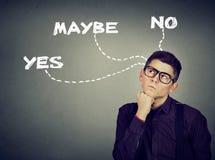 Thinking undecided man has doubts. Thinking undecided young man has doubts Stock Images
