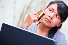 Thinking about using credit card Stock Image