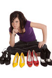 Thinking what to wear. A teen girl is trying to figure out which shoes to wear Royalty Free Stock Photo