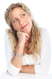 Thinking woman. Thinking smiling woman. Isolated over white background Royalty Free Stock Images