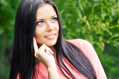 Thinking woman. Young beautiful thinking woman outdoors - closeup portrait Royalty Free Stock Images
