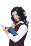 Thinking woman with agenda and pencil Royalty Free Stock Images