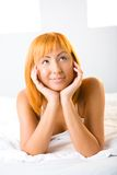 Thinking woman in bed Royalty Free Stock Images