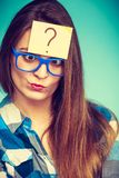 Thinking woman with big eyeglasses and light bulb Royalty Free Stock Photography
