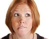 Thinking Woman Biting Her Lip Stock Photo