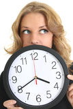 Thinking woman in black with clock. Over white Stock Photos
