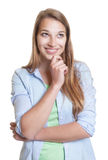 Thinking woman with blond hair in casual clothes Royalty Free Stock Image