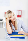 Thinking woman with books Royalty Free Stock Photo