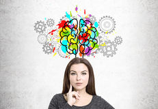 Thinking woman, brain and cogs Stock Photo