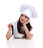 Thinking woman chef keeping knife Royalty Free Stock Photography