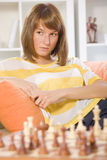 Thinking woman with chess game Stock Photos