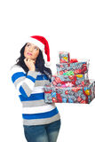 Thinking woman with Christmas gifts Stock Photo