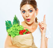 Thinking woman close up portrait with green food Stock Images